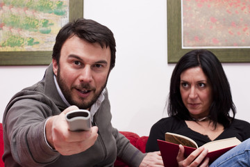 Funny Adult Couple Watching Television at Home
