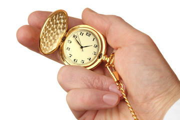 Golden pocket watch in a businessman's hand.