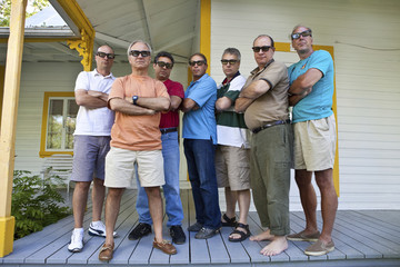 Group of serious middle aged men
