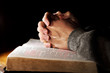 Leinwanddruck Bild - Praying Hands with Holy Bible