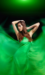 Dynamic image of a beautiful woman shot in green spring concept