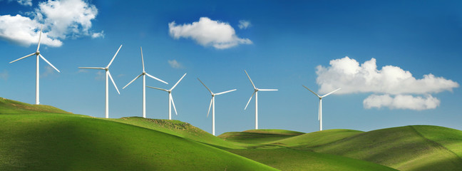Wind turbines on green hills
