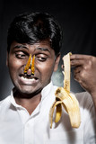 Indian man holding rotten banana poster