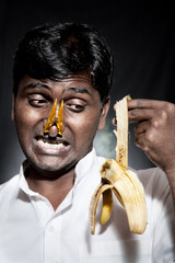Indian man holding rotten banana