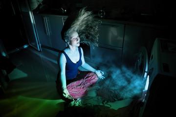Woman near by washing machine underwater