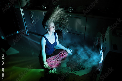Woman near by washing machine underwater