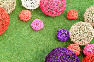 color rattan ball on green grass..
