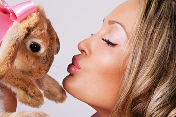 Lovely girl with cute rabbit
