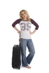 Woman waiting with suitcase