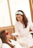 Beautician doing tooth whitening