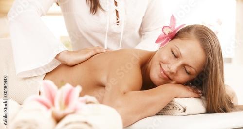 Smiling woman enjoying back massage