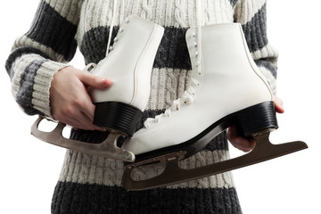 Women holding ice skates