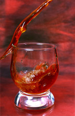 alcohol drink pouring into glass