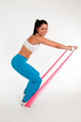 woman exercising with rubber ribbon