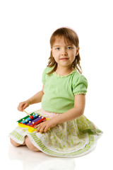 Girl playing on xylophone