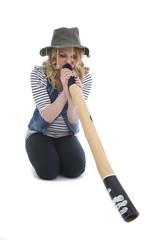 Woman playing didgeridoo