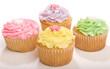 Four Pastel Cupcakes