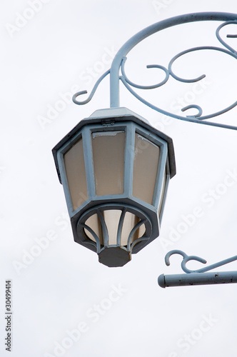 image of lamp pole with white cloud as background