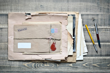 Old envelopes with papers a on wooden table