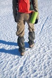 gaiters on trousers of trekking woman