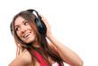 cheerful brunette woman listening and enjoying music