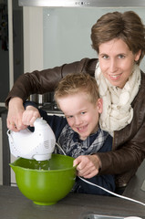 Mother and son mixing the dough