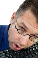 male nerdy geek fall asleep on keyboard