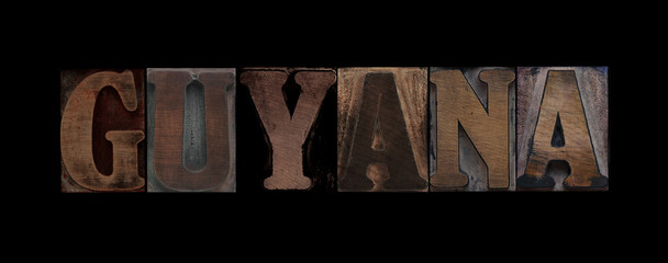 the word Guyana in old letterpress wood type