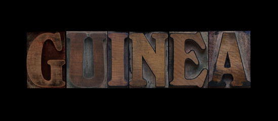 the word Guinea in old letterpress wood type