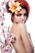 Portrait of beautiful woman with cherry flowers  on white