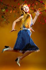 Cheerful redhead girl indoors