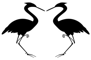 Silhouette of two herons