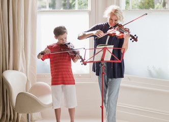 Woman and boy playing violin