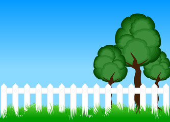 Fence on meadow with trees