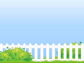 Lawn with fence and bush