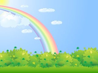 Meadow with green hedge and rainbow