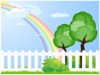 Fence on meadow with tree and rainbow