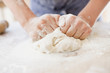 Close up of girl kneading dough