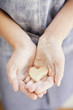 Close up of girl holding heart-shape dough