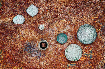 The old rusty clock and the ancient coins