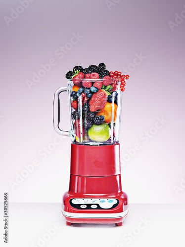 Variety of fruit crammed in blender