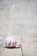 Close up of purple garlic on wooden board