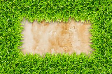 green grass frame on vintage paper background