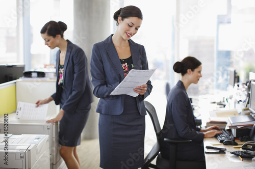 Sequence of businesswoman working in office
