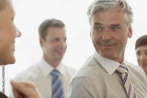 Businessman listening to businesswoman