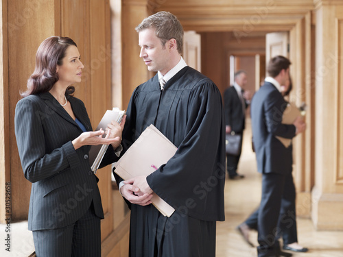 Judge and lawyer talking in corridor