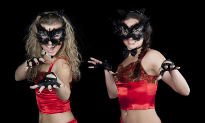 Two women in red suits and masks cat