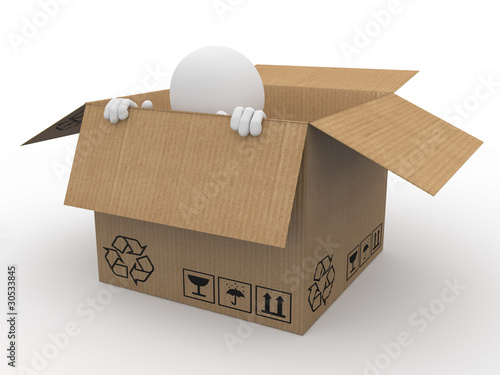 Man hiding in a cardboard box, scared