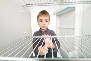 Boy and Empty Refrigerator