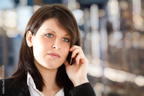 Young girl talking at phone
